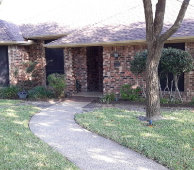 Senior home with landscaped exterior in Richardson TX